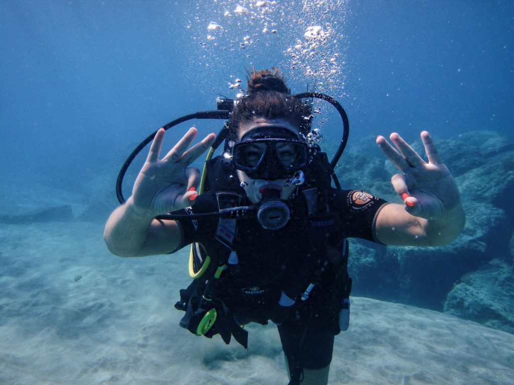 Nadia El Ferdaoussi Travel blogger Tenerife TenDive underwater scuba diving try dive. Everything you need to know about your first scuba dive