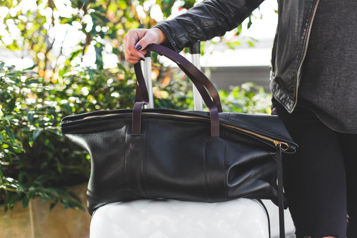Packing tips pro travel blogger Nadia El Ferdaoussi the daily self Kinsale leather Kane weekender bag Penneys Primark suitcase