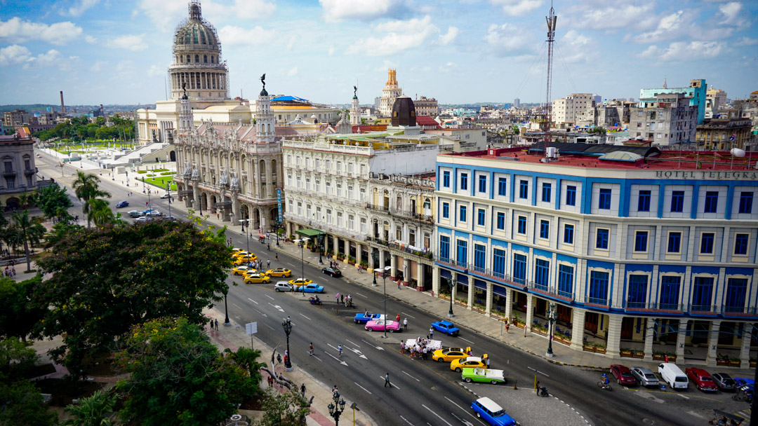 Photo of Havana streets, classic cars and Capitol building taken from Hotel Parque Central rooftop