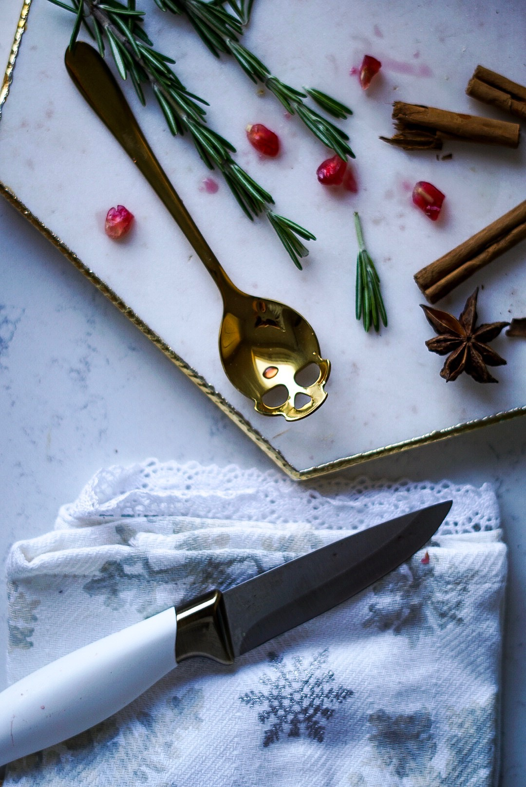 TK Maxx white marble chopping board with rosemary, pomegranate, cinnamon, star anise and orange