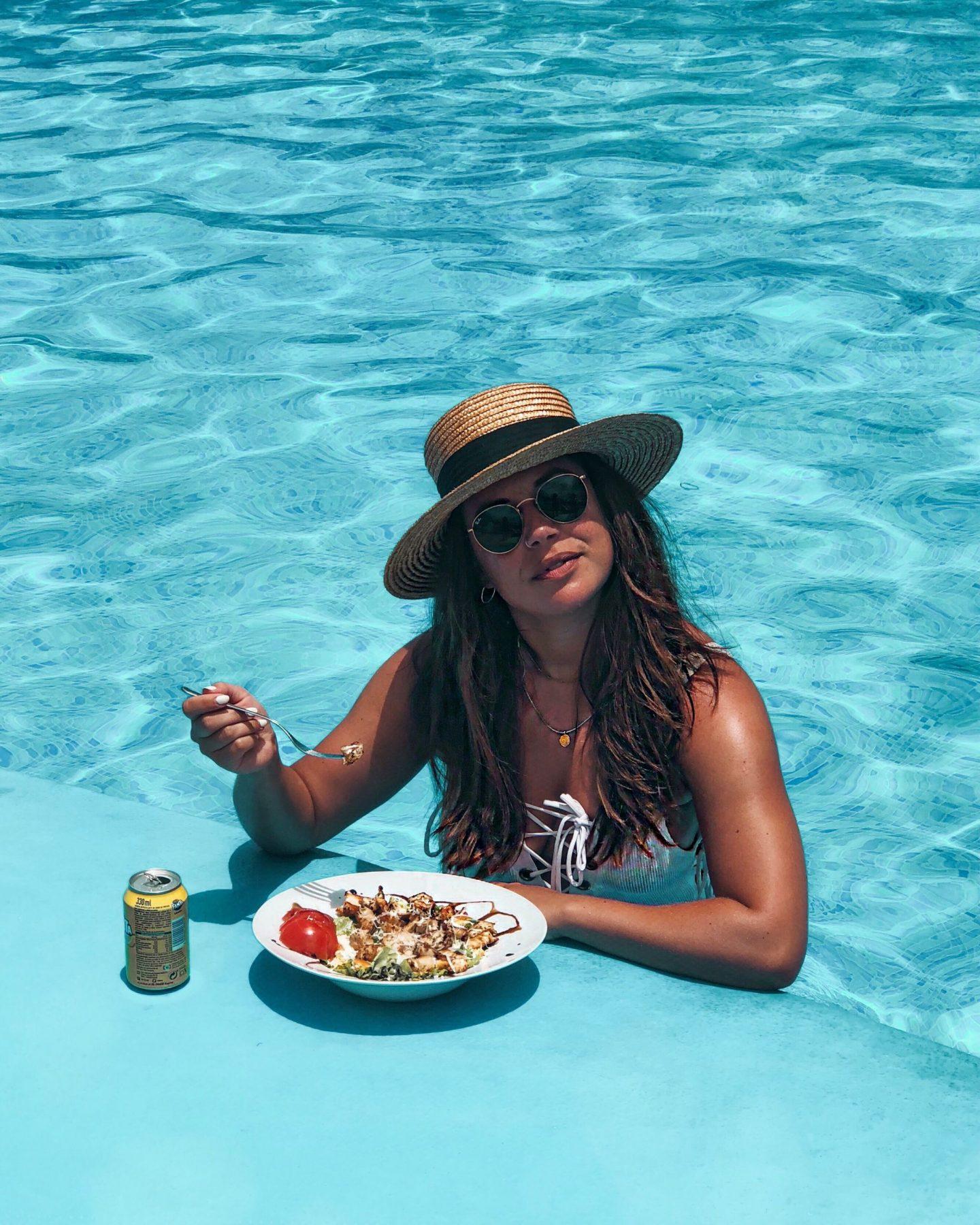 Nadia El Ferdaoussi holiday essentials polarised Ray Ban sunglasses