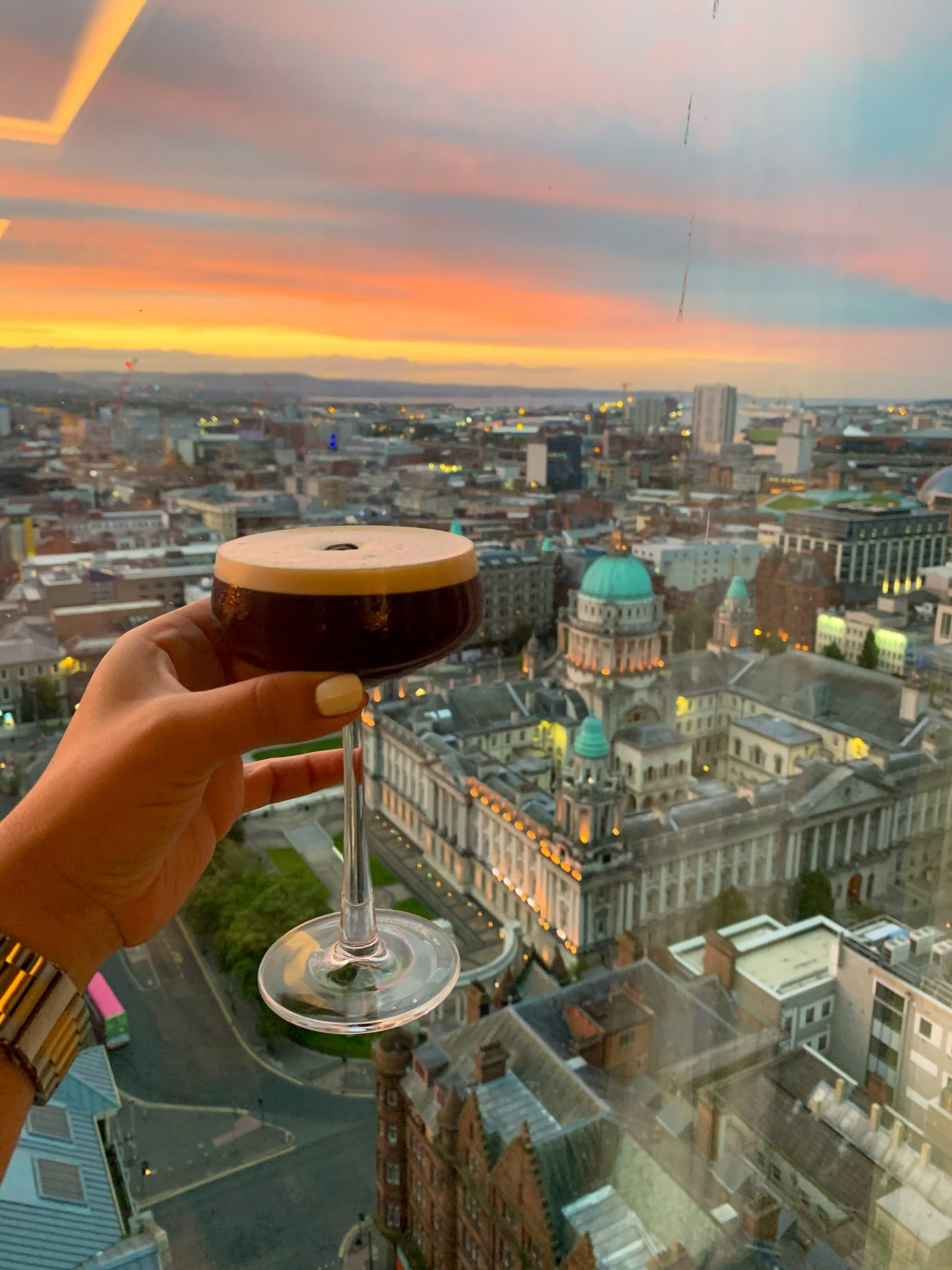 Espresso martini with a view of Belfast from the Observatory bar at the Grand Central hotel