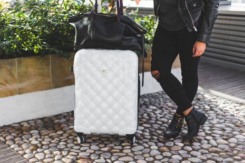 Packing tips pro travel blogger Nadia El Ferdaoussi the daily self Kinsale leather Kane weekender bag Penneys Primark suitcase Office Lucky Charm studded buckle western boots