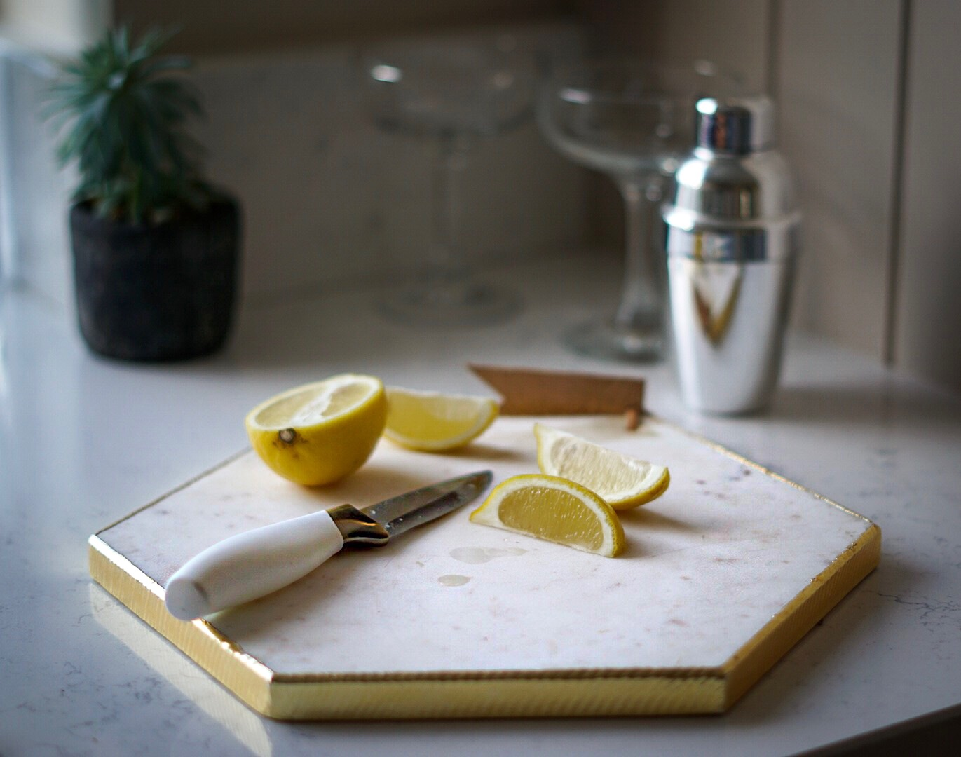 TK Maxx white and gold marble chopping board and bottle opener and cocktail shaker
