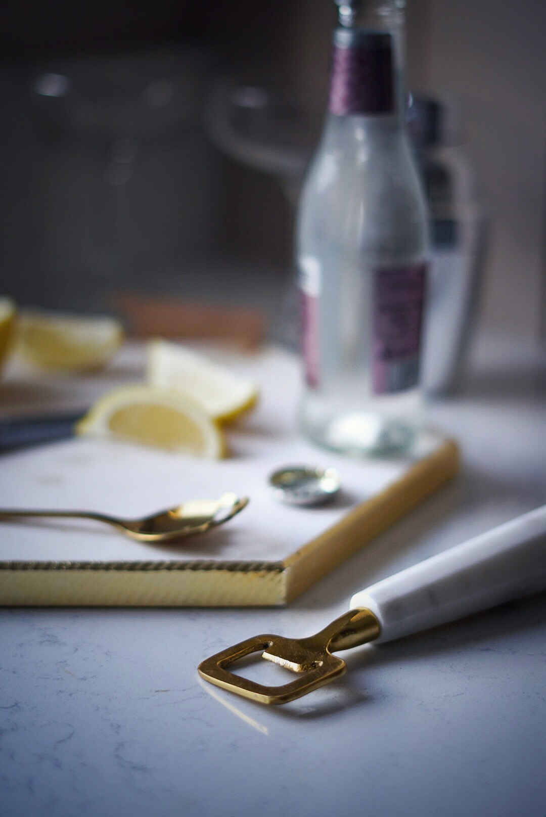 TK Maxx white and gold marble chopping board and bottle opener