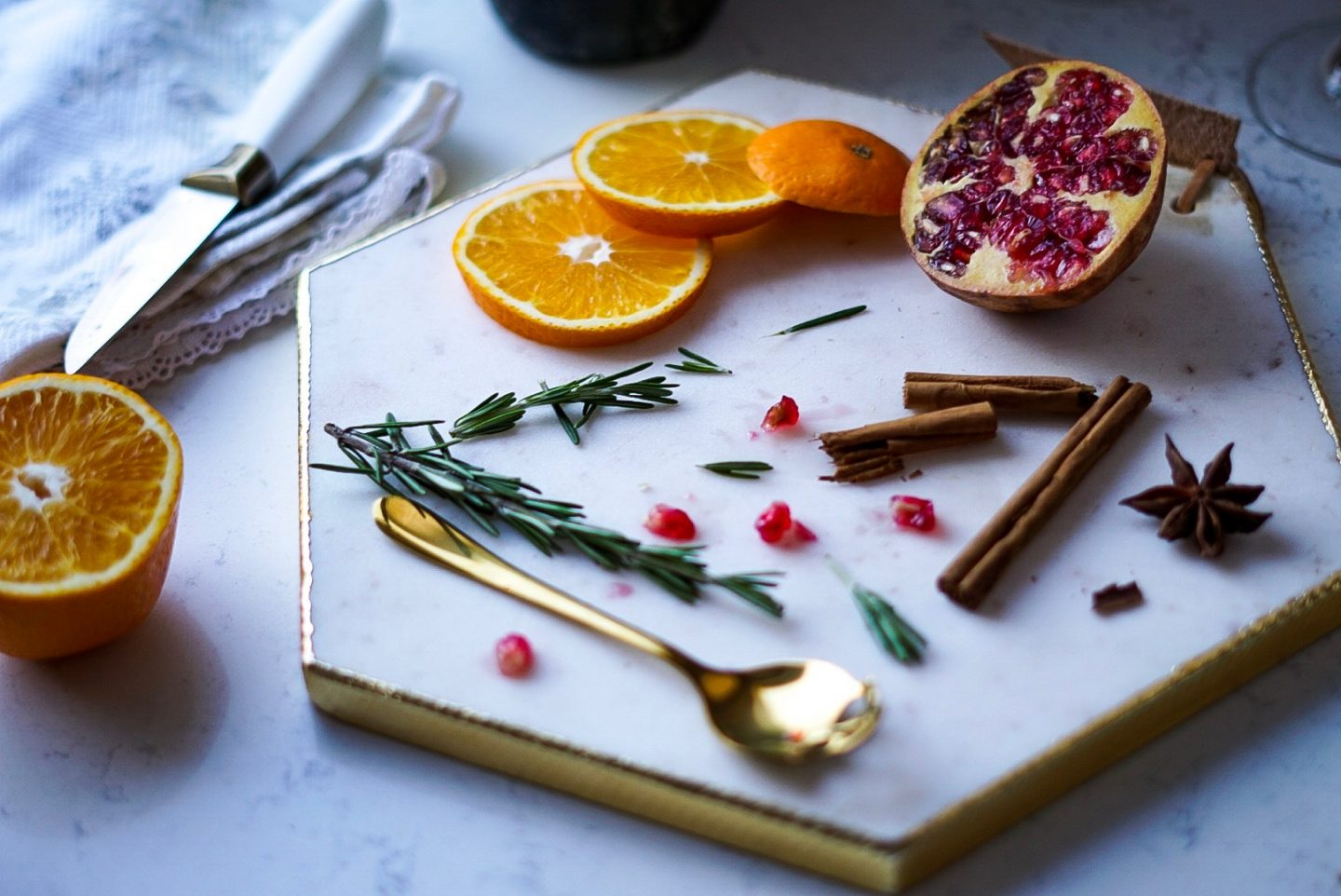 TK Maxx marble white chopping board with rosemary, pomegranate, cinnamon, star anise and orange