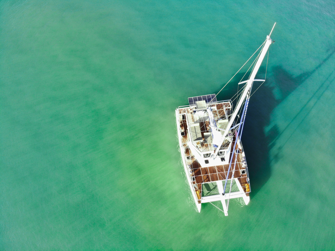 Drone shot of G Adventures 53ft catamaran sailing off the southern coast of Sri Lanka