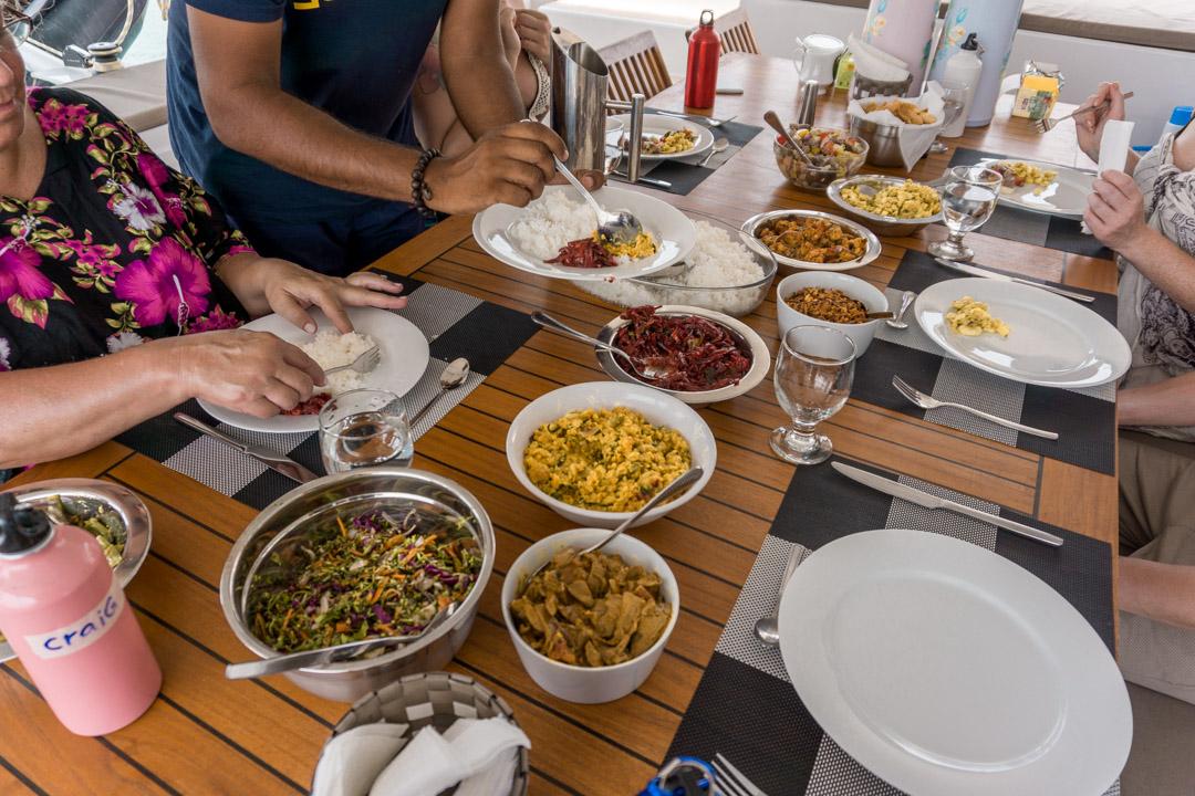 Chef cooking on board G Adventures Southern Sri Lanka sailing trip 53ft catamaran